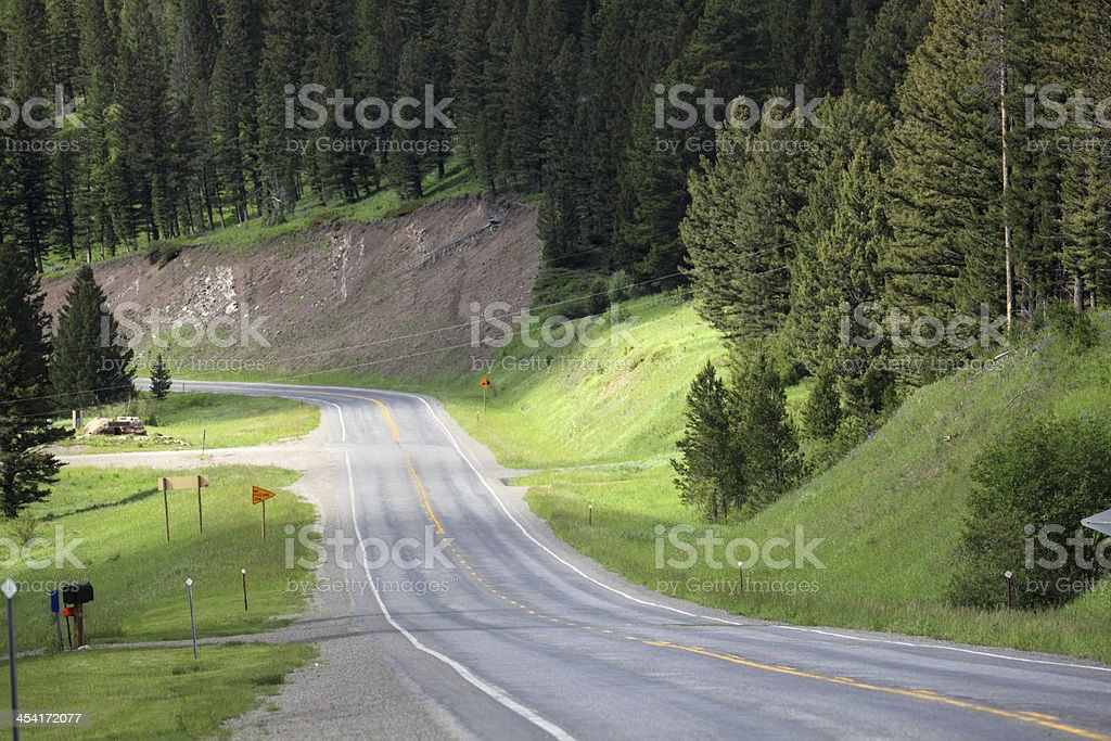 empty montana mountain highway with forest in summer royalty-free stock photo