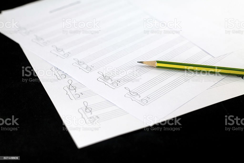 Empty music sheet with pencil stock photo