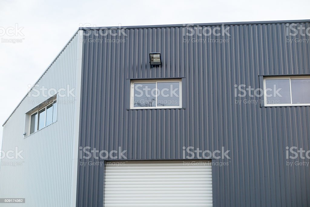 Empty new office building on business parkon blue sky stock photo