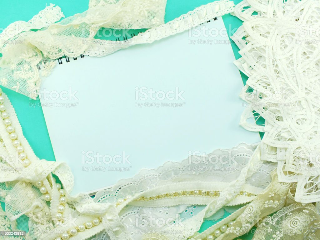 empty note book opening with lace decor background stock photo