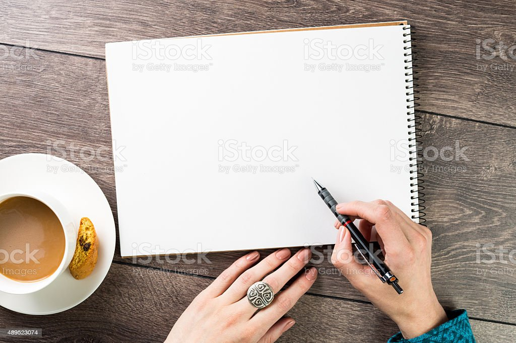 Empty note skechbook on the table stock photo