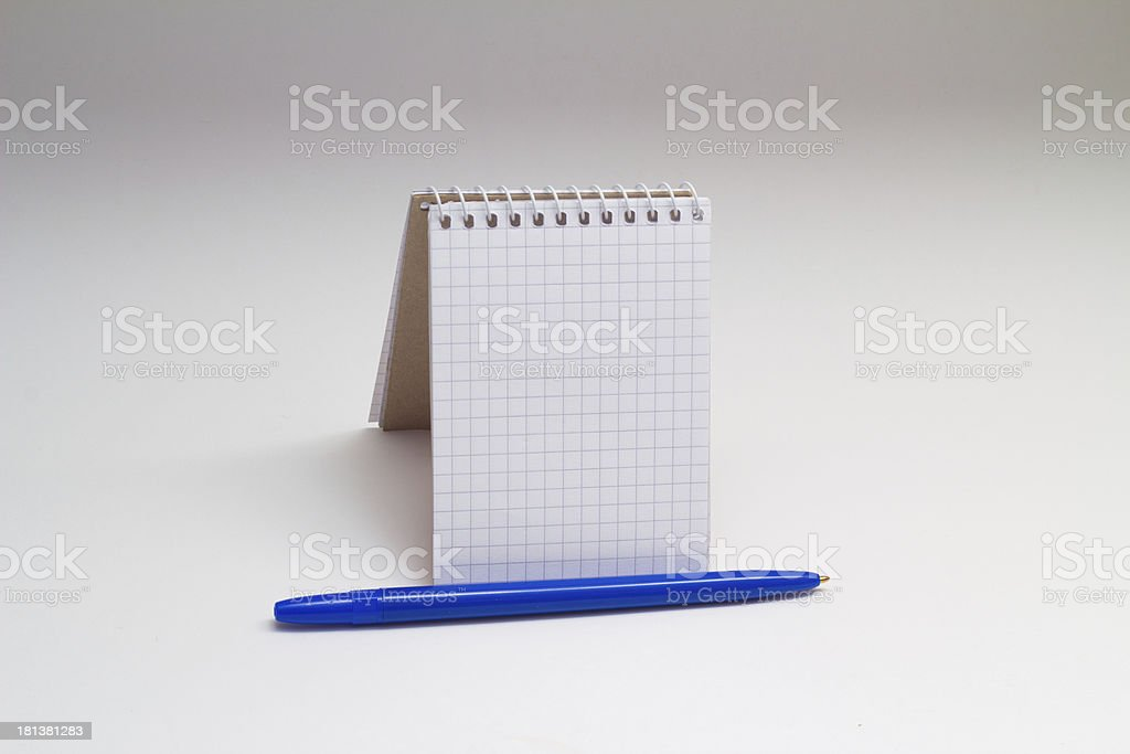 empty notebook and blue pen stock photo