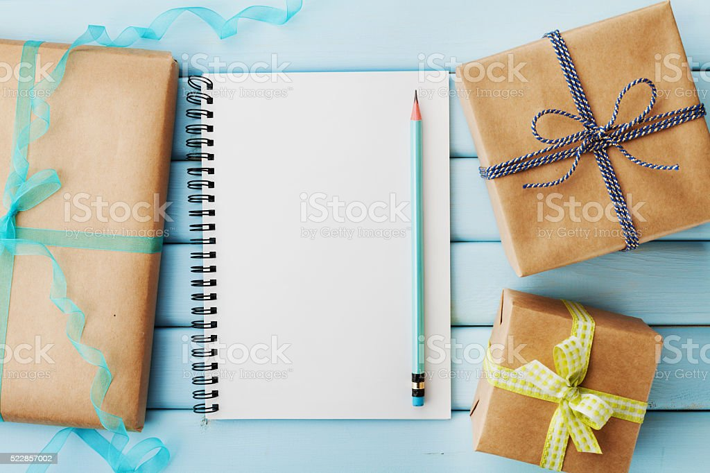 Empty notebook, pencil and gift or present box stock photo