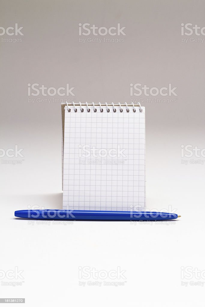 Empty notebook with blue pen on white background stock photo