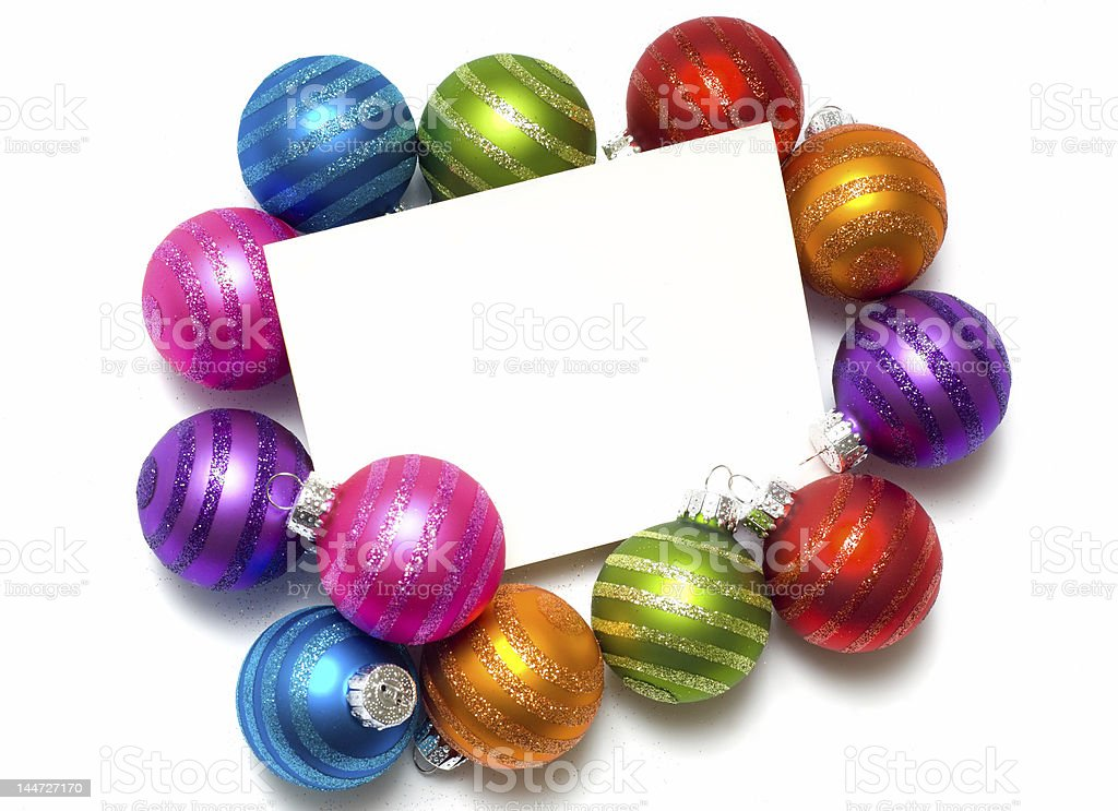 Empty note-card surrounded by colorful Christmas balls royalty-free stock photo