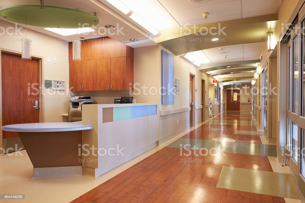 Empty Nurses Station And Corridor In Modern Hospital stock photo