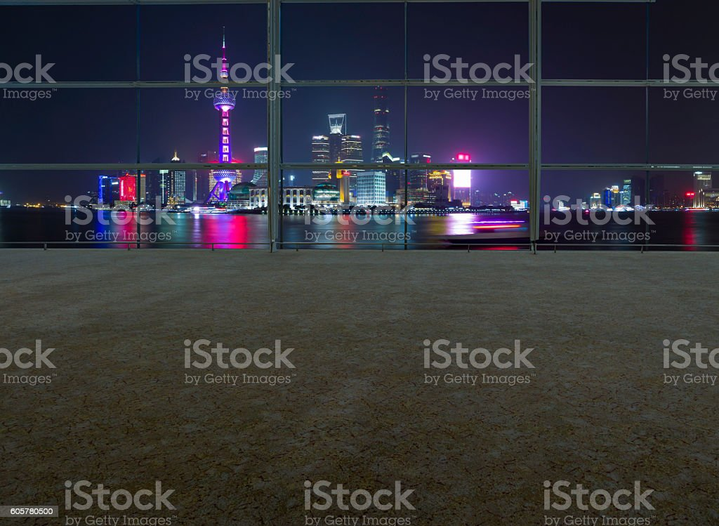 Empty office and shanghai skyline at night stock photo