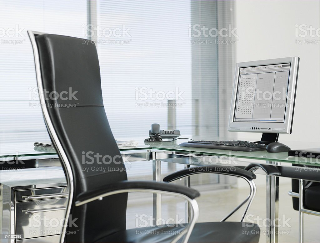Empty office with chair and computer stock photo