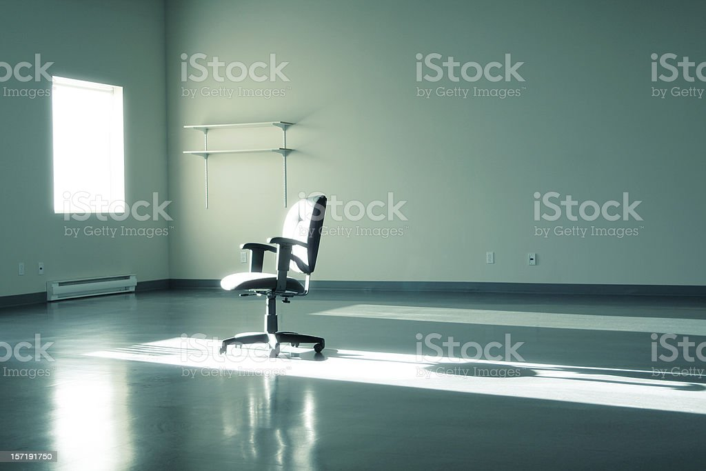 Empty office with chair sitting in the sun royalty-free stock photo