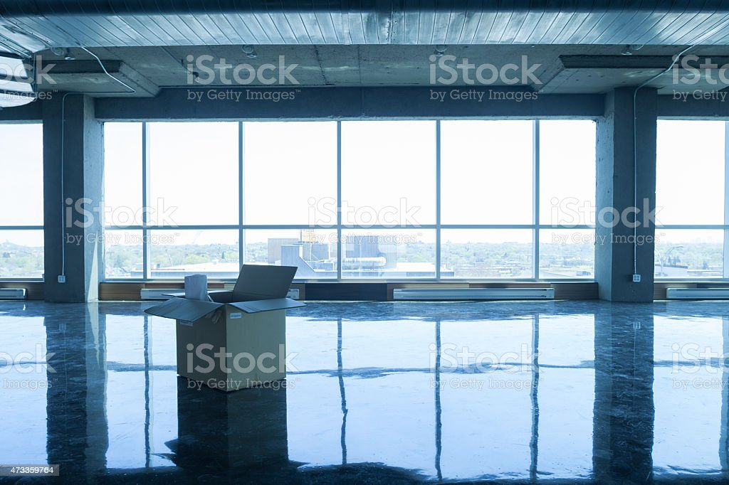 empty office with moving box stock photo