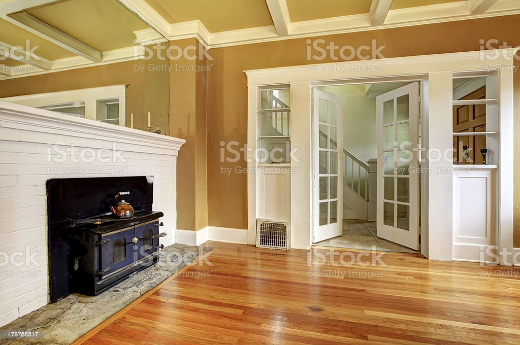 Empty old living room with an antique stove stock photo