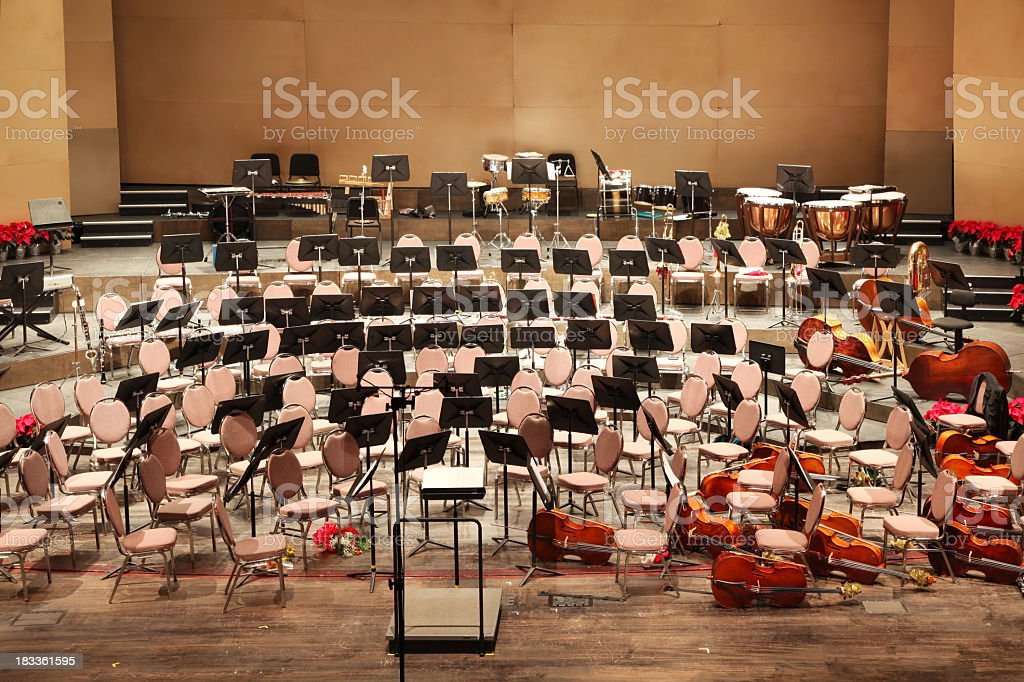 Empty orchestra seats arranged on a stage stock photo