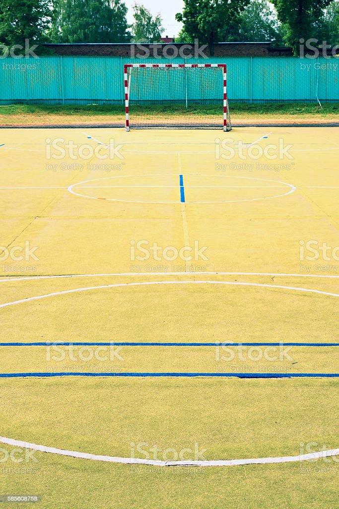 Empty outdoor handball playground, plastic light green surface stock photo