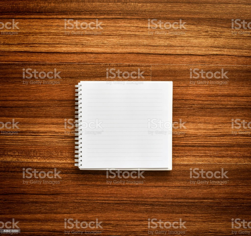 Empty page spiral notebook on wood background. stock photo