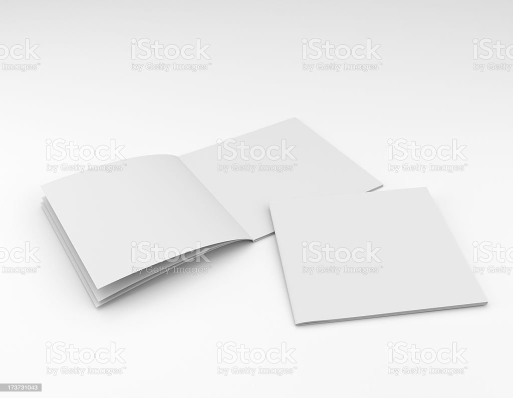 Empty pages of a book scattered on a white background stock photo