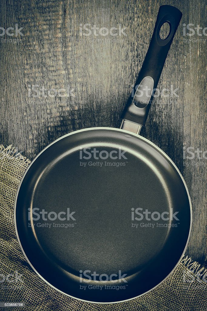 Empty pan on a wooden table stock photo