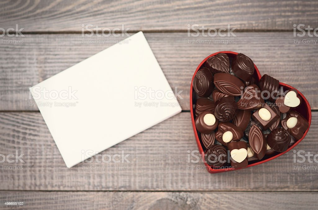 Empty paper and opened chocolate box stock photo