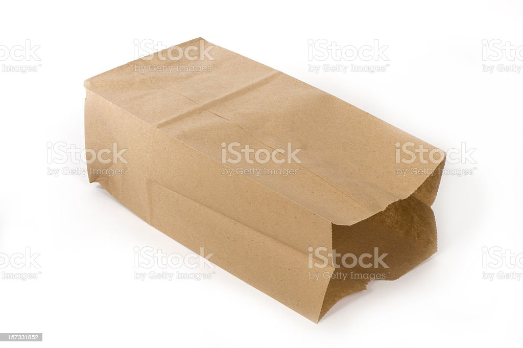 Empty paper lunch bag on its side royalty-free stock photo