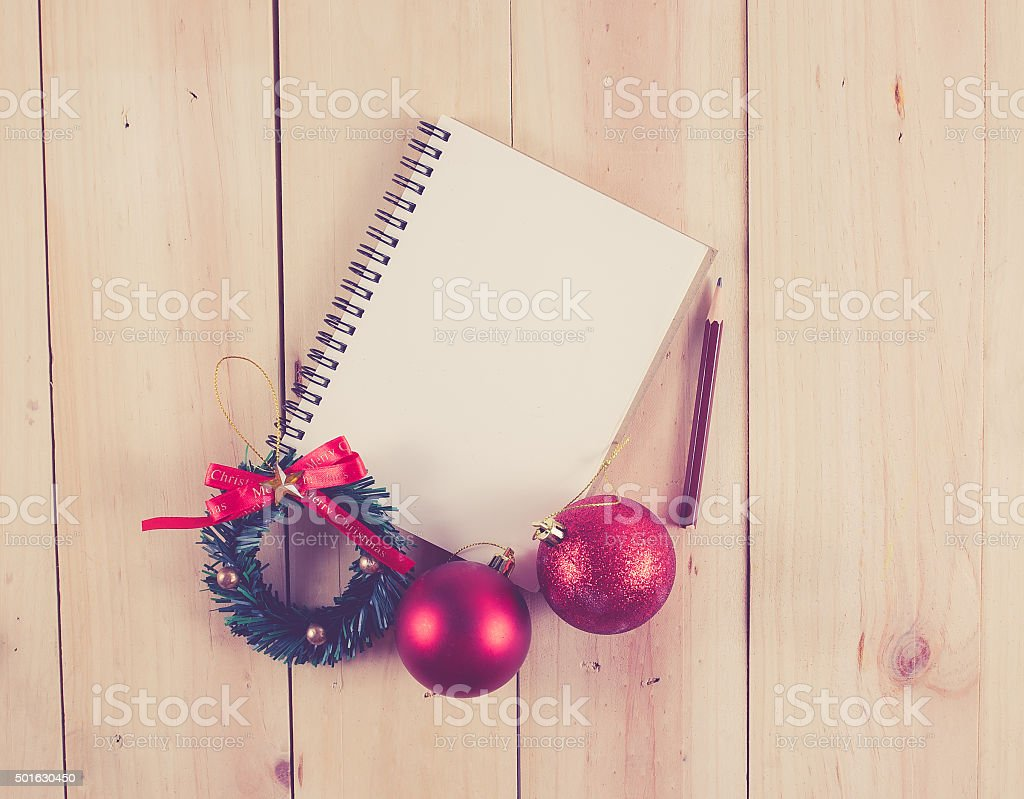 Empty paper note with Christmas balls on wooden background,Chris stock photo