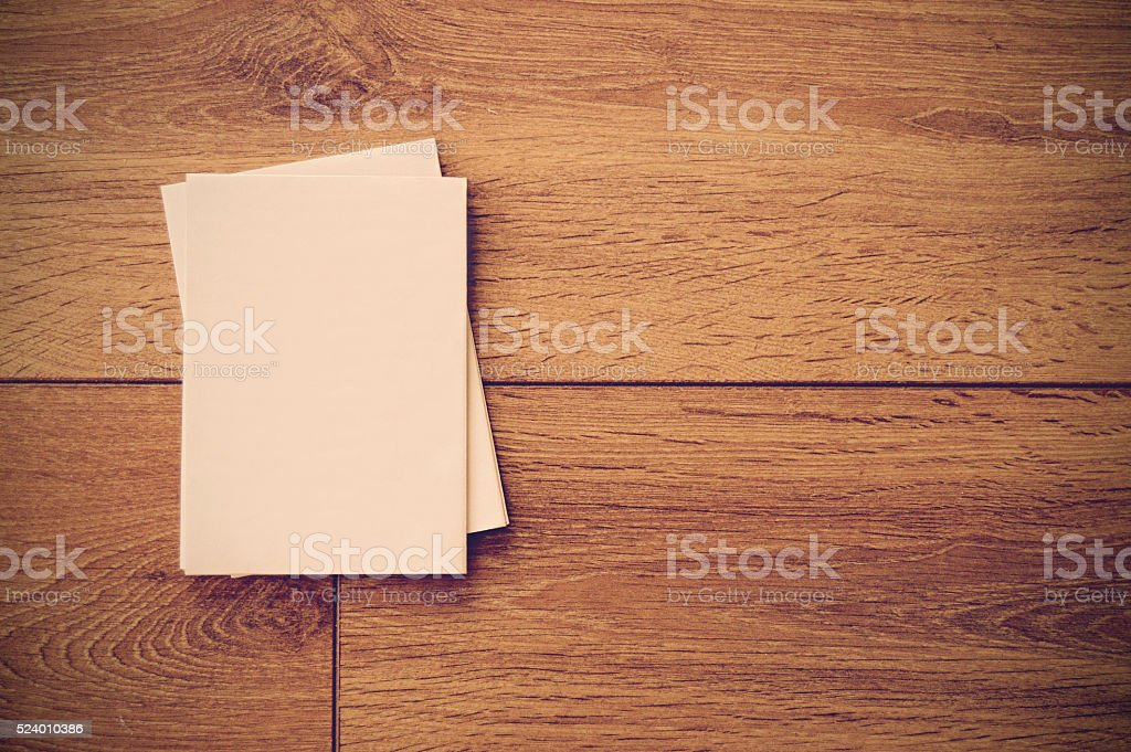 Empty paper on a wooden table - top view stock photo