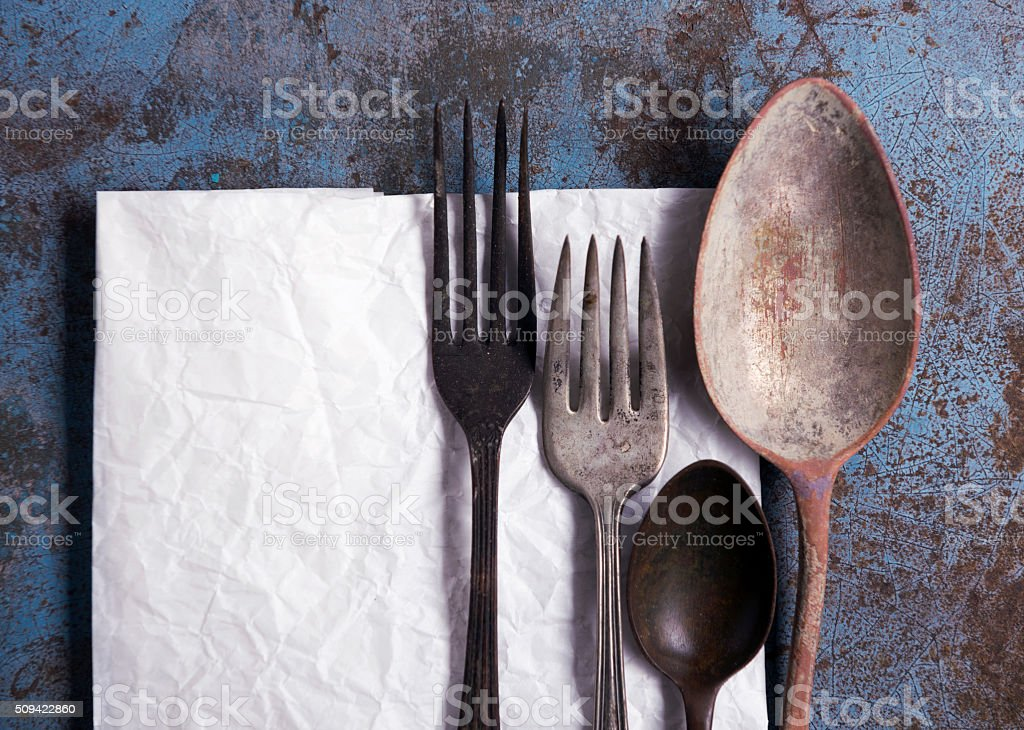 Empty Paper with fork and spoon stock photo