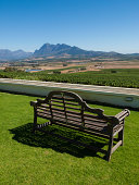 Empty Park Bench overlooking wineries and mountains