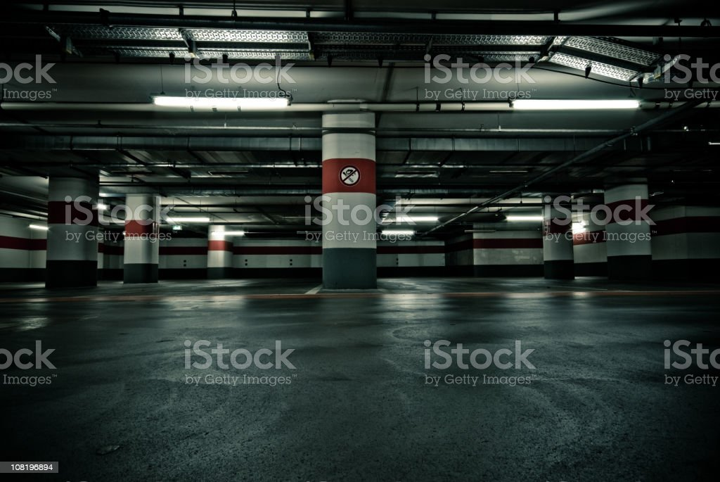 Empty Parking Garage with No Smoking Sign stock photo