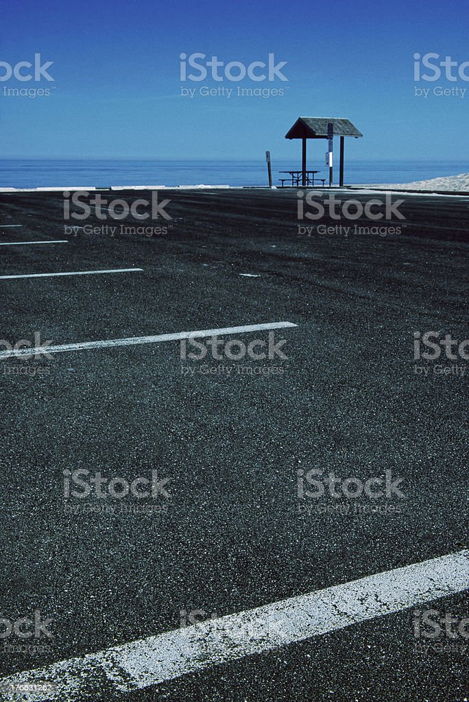 Empty parking lot at beach with Lake Michigan in distance stock photo