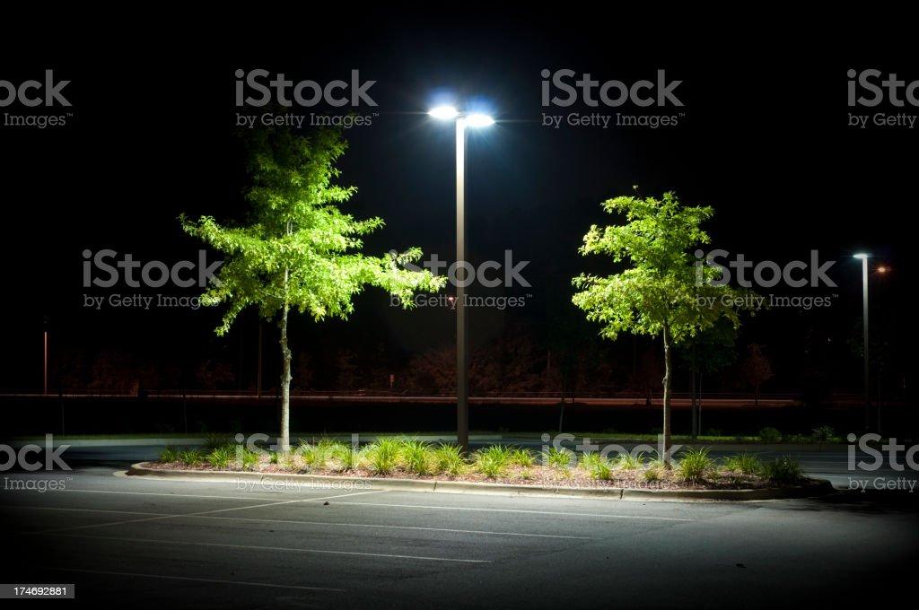 Empty Parking Lot at Night stock photo