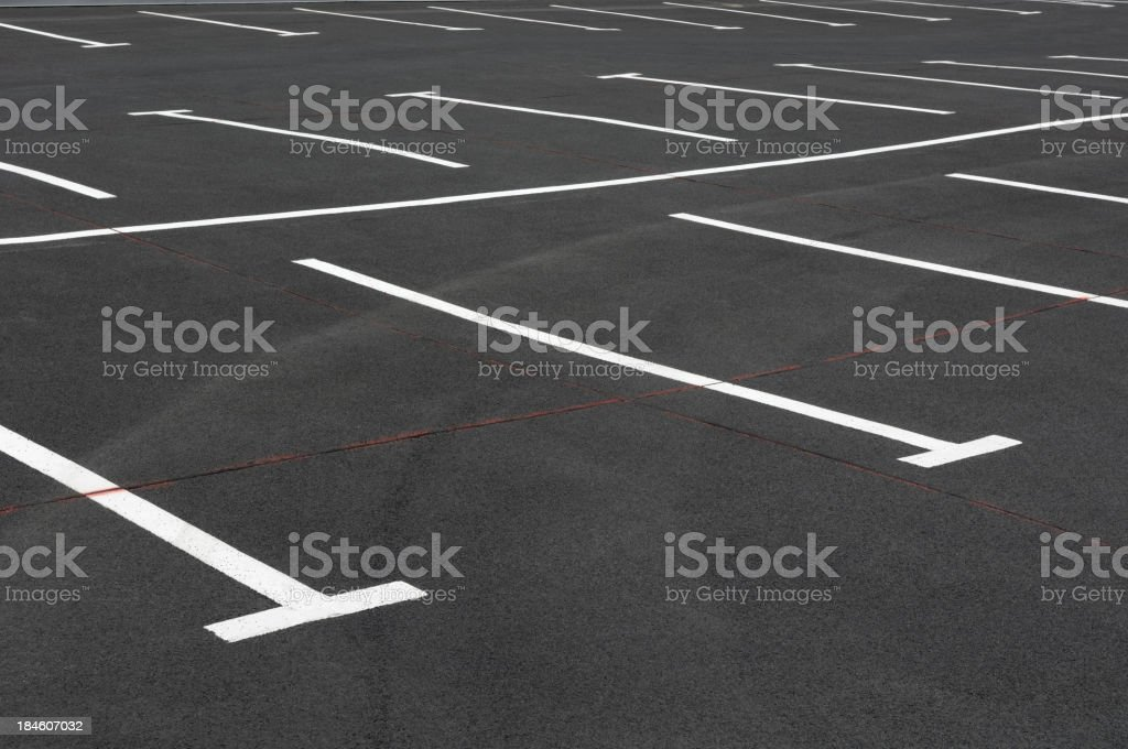 Empty parking lot with white lines royalty-free stock photo