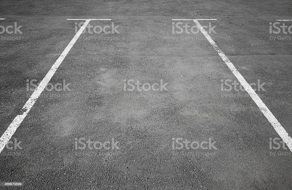 Empty parking place with white marking lines on asphalt stock photo