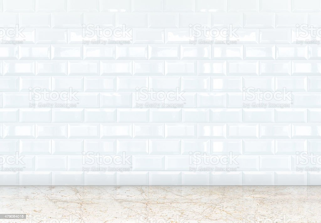 empty perspective room with white ceramic tiles wall and marble stock photo