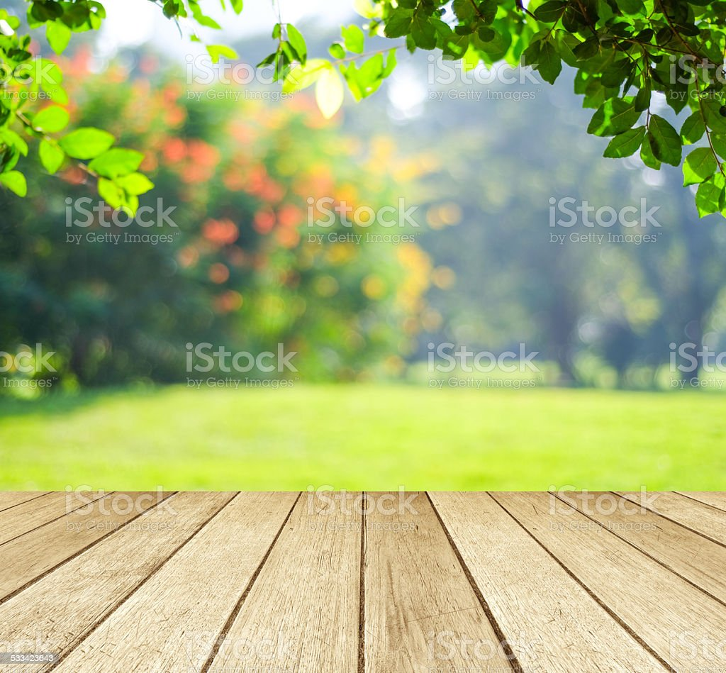 Empty perspective wood over blur trees with bokeh background stock photo