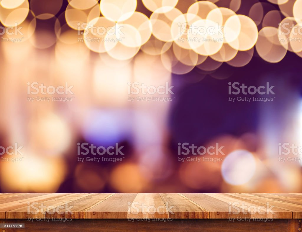 Empty perspective wood plank table top with abstract bokeh light stock photo