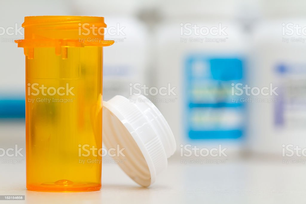 empty pharmacy vial and cap royalty-free stock photo