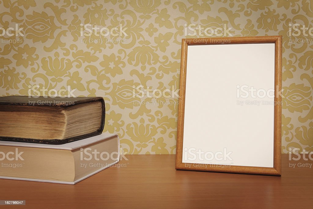 Empty Photo Frame and Books on the Table stock photo