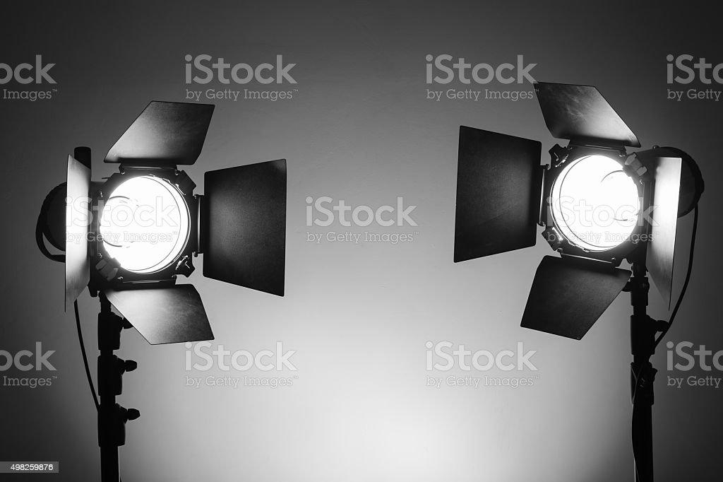 Empty photo studio with lighting equipment stock photo