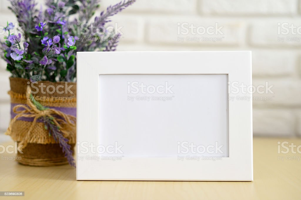 empty Picture Frame and flowers in a pot stock photo