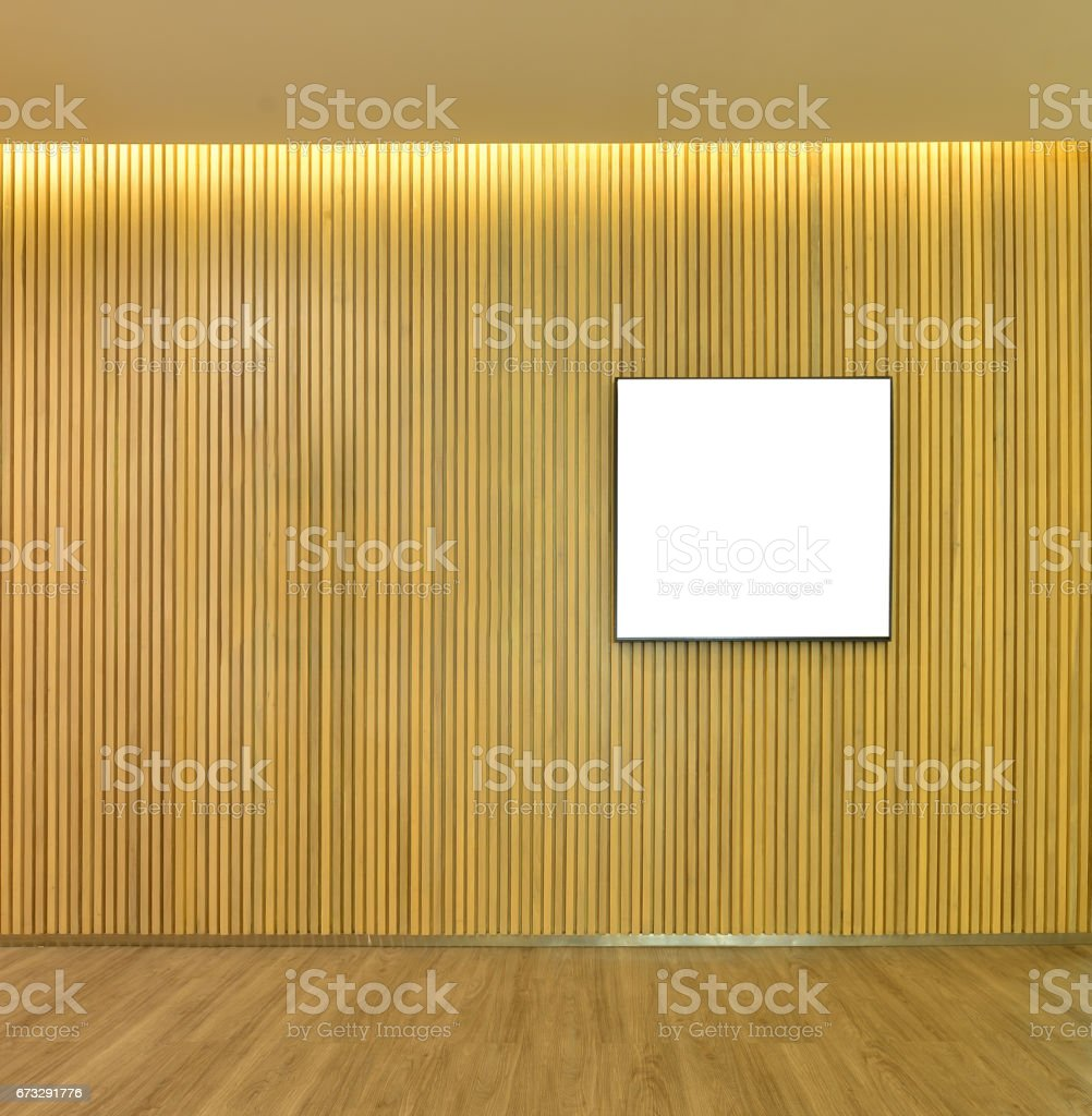 Empty picture frame in wood slats wall inside of home, mock up stock photo