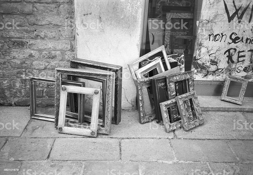Empty picture frames abandoned in the street stock photo