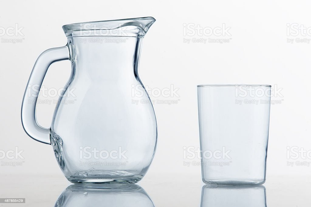 Empty pitcher and glass cup stock photo