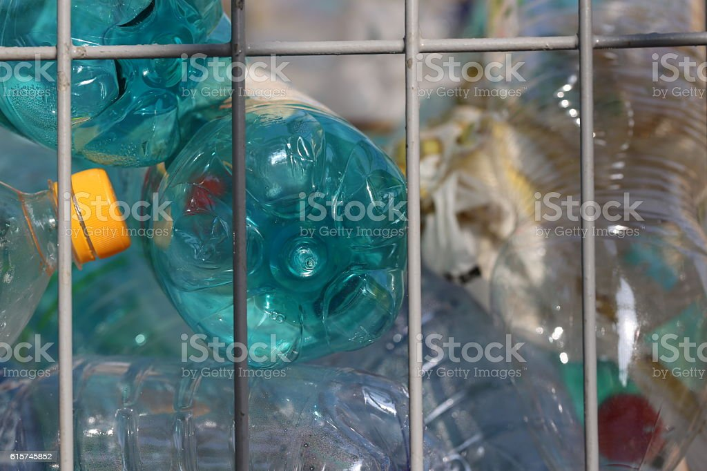 Empty Plastic Bottles in a Recycling Container. stock photo