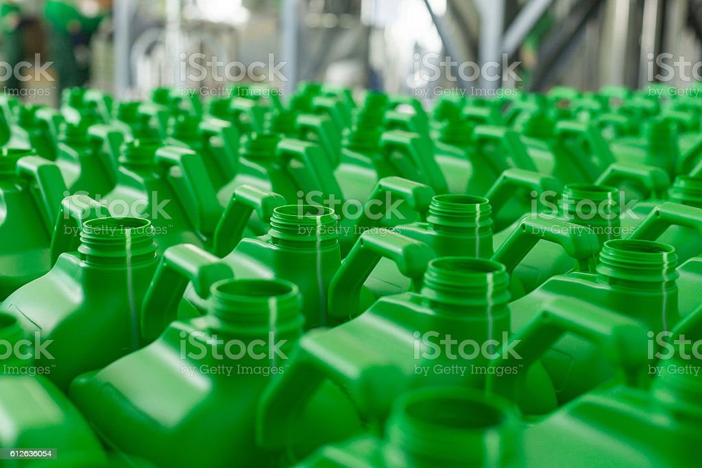 Empty plastic cans green colour. stock photo