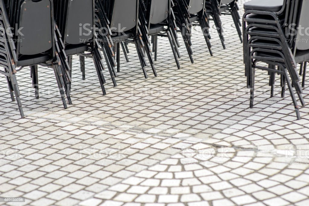 empty plastic seats in public square stock photo