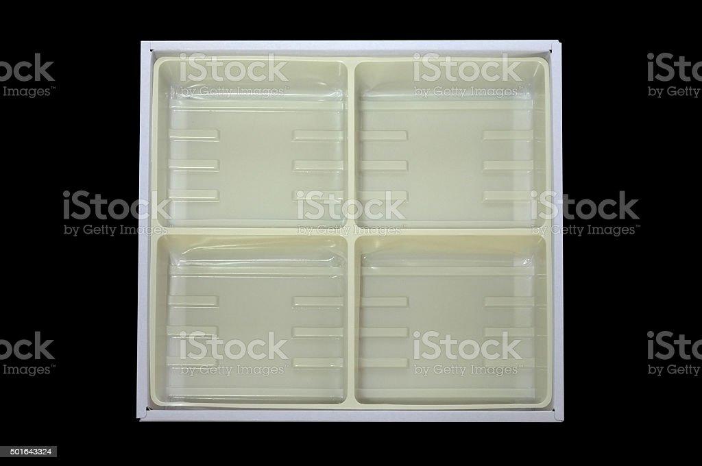 Empty plastic tray inside paper box stock photo