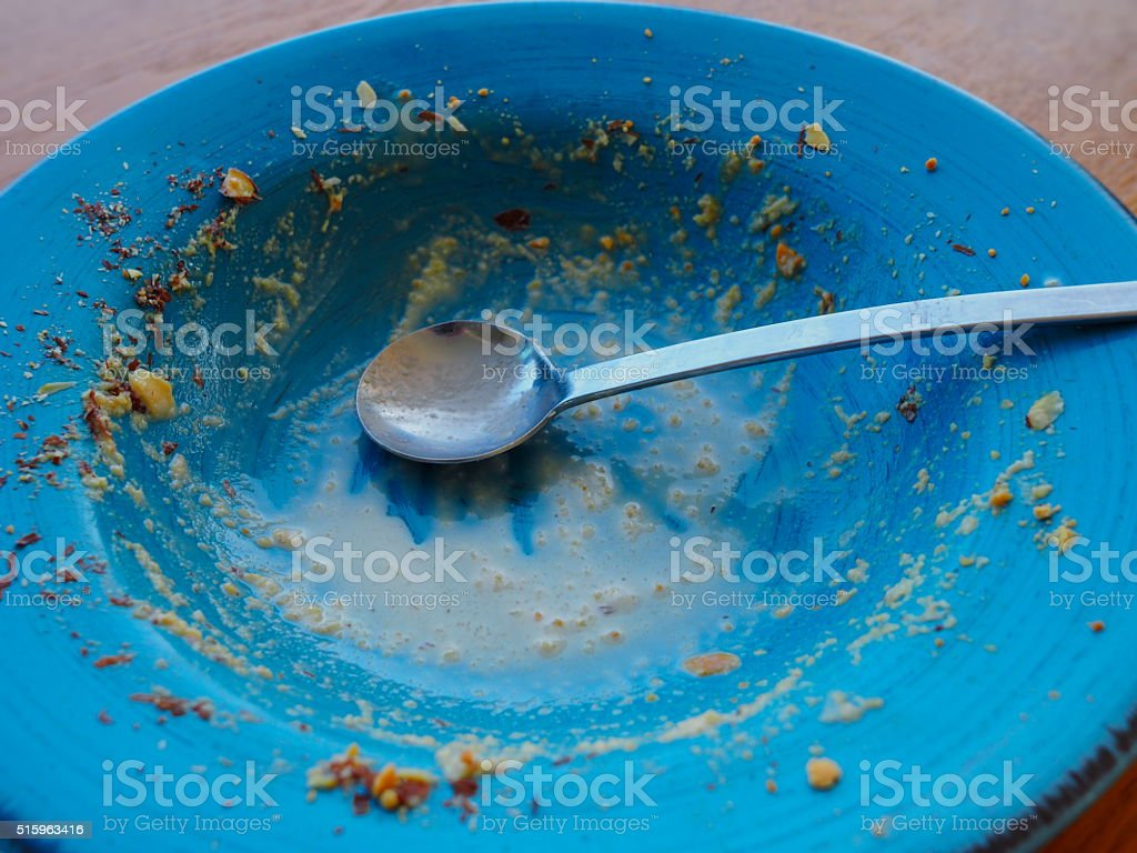 Empty plate after eating peanut flaked ice cream stock photo