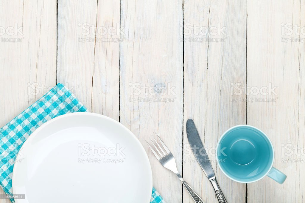 Empty plate, cup and silverware stock photo
