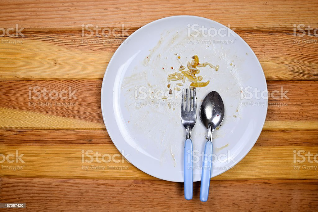 empty plate, dirty after the meal is finished. stock photo