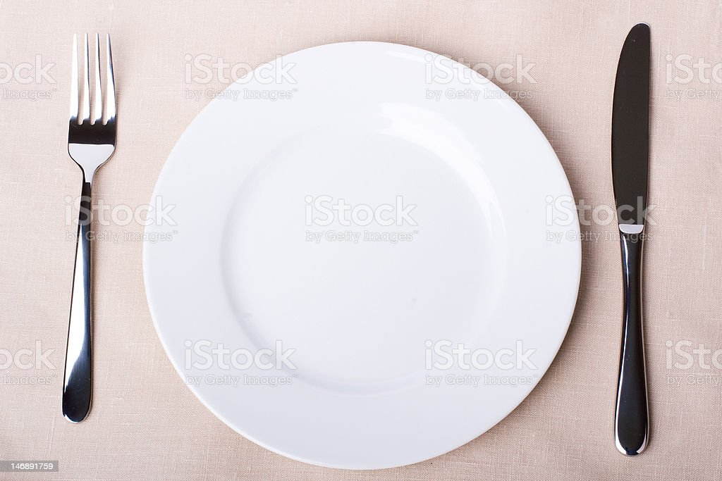 Empty plate, fork and knife royalty-free stock photo