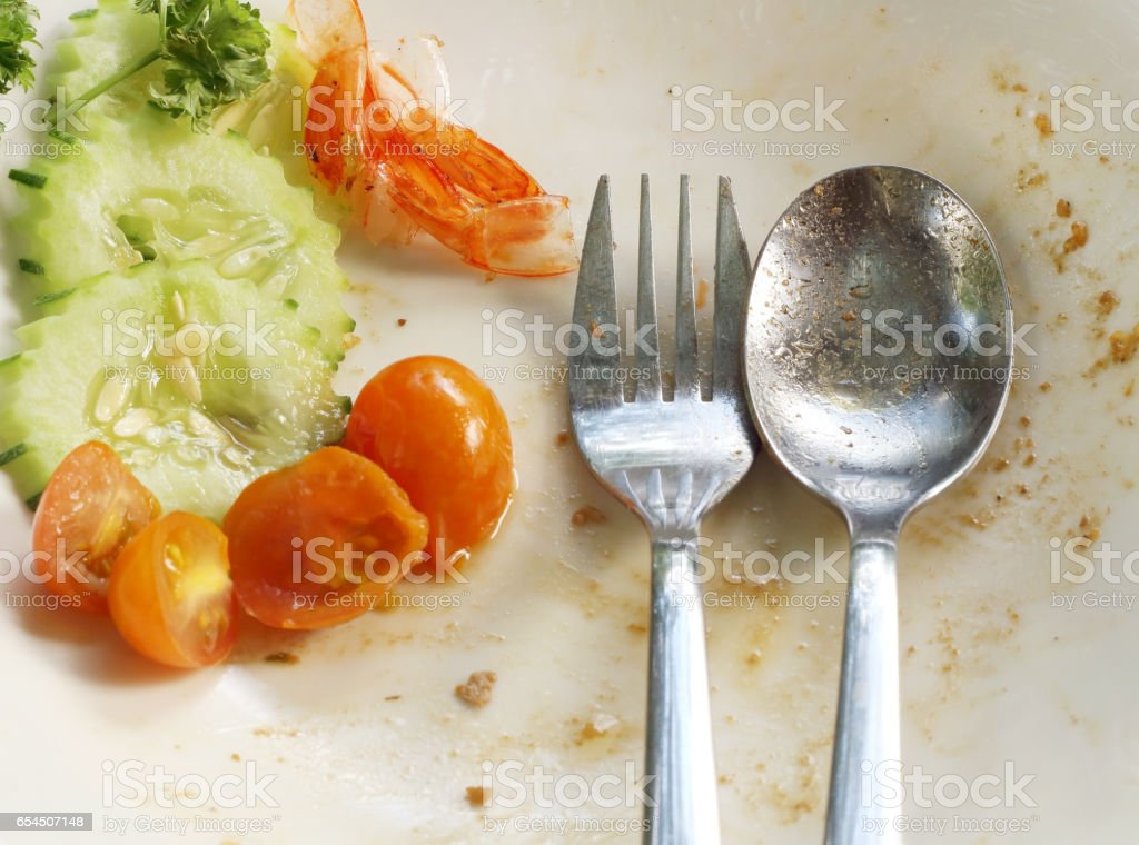Empty plate left after eating, leftover food stock photo